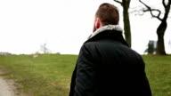 Man walking in a park outside video