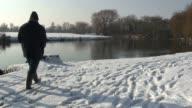 Man walking in the snow. video