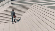 Man walking in urban setting video
