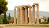 Man walking near remains of Olympian Zeus Temple in Athens, tourist attraction video
