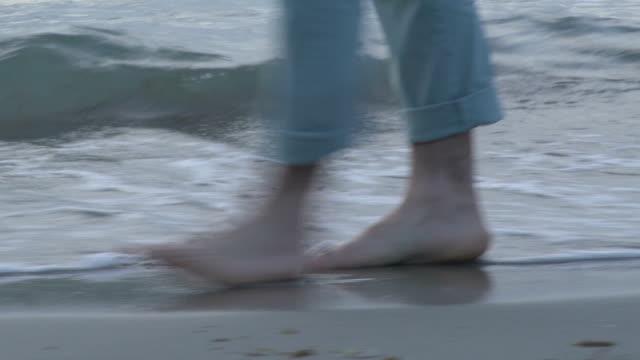 Man walking on beach video