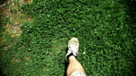 Man Walking on dirt and grass video
