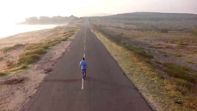 Man walking on street aerial view video