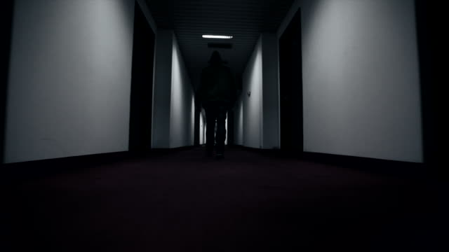 Man walking through hotel corridor video