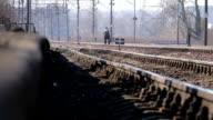 Man walking through railroad track video