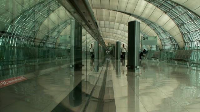 Man Walking to Airport Terminal Departure Gate video