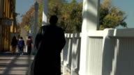 Man walkng on bridge video