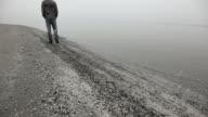Man walks alone on the Beach video