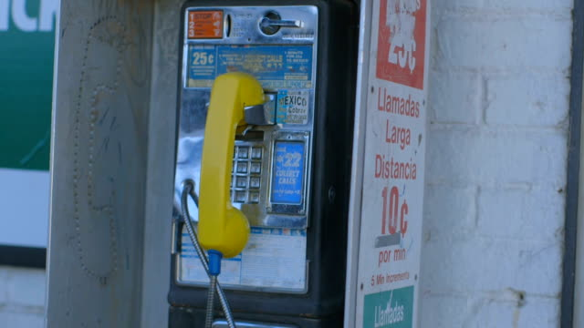 Man Walks by Pay Phone video