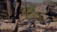 Man walks mountain trail video