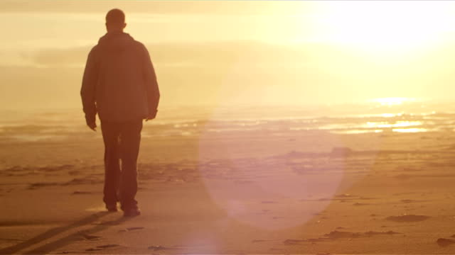 Man walks on the beach video
