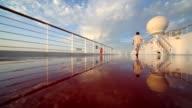 Man walks on wet deck of cruise ship video