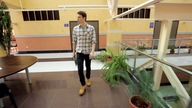 Man walks through corridors in empty shopping mall video