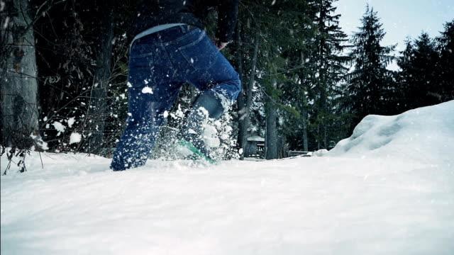 Man Walks Through Deep Snow In The Woods video