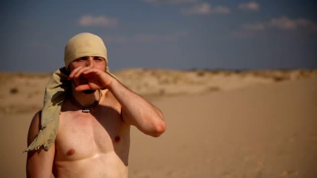 A man walks through the desert video