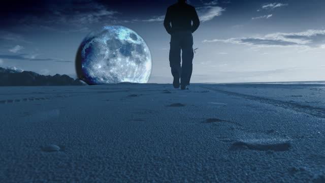 Man walks towards moon rising in HD video