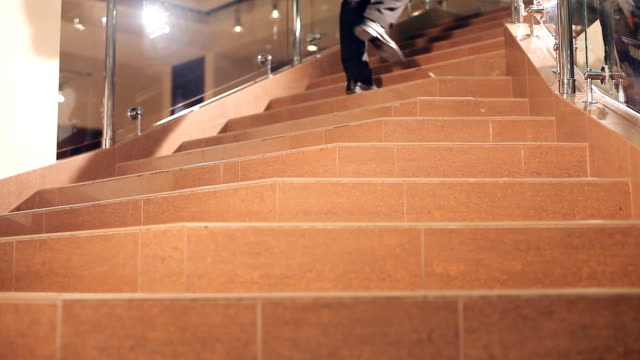 Man walks up the stairs video