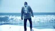 Man wandering outdoors in winter video