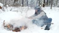 Man Warm Hands by Winter Campfire video