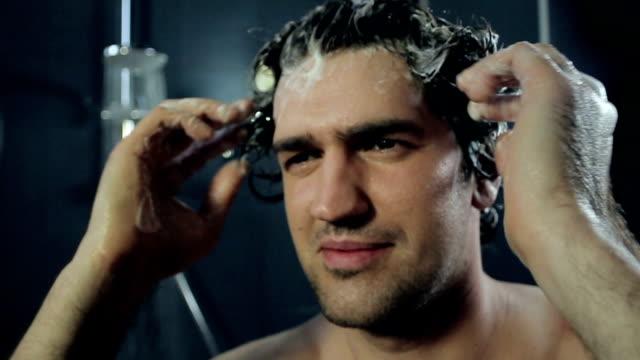 Man washes his hair video