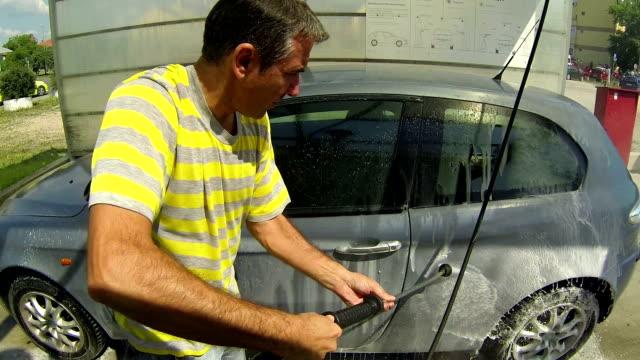 Man Washing Car At Service Station video