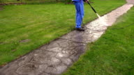 Man Washing Concrete Path With Pressure Washer video