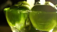 Man washing green apples in a glass bowl, slow motion video video