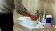 Man washing his hands video