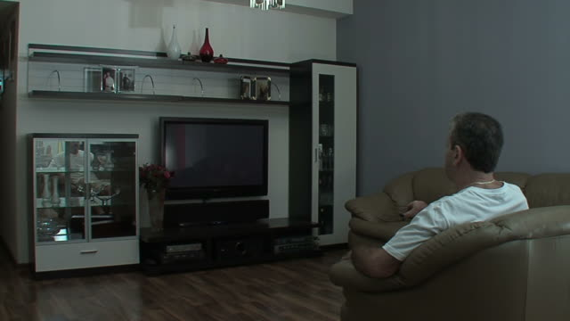 Man watches TV in the sitting room video
