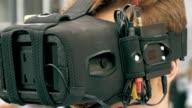Man watching flight of FPV drone using VR glasses video