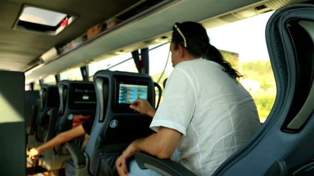 Man watching tv on the bus video