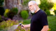 Man Watering Plants video