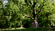 Man wearing a grey shirt walking up a hill video