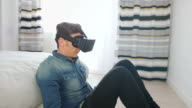 Man wearing a virtual reality headset at home. video