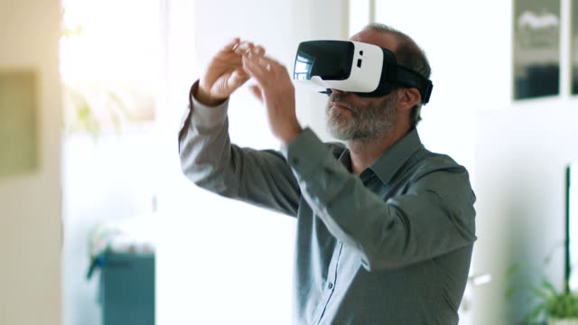 Man wearing and working with VR goggles video