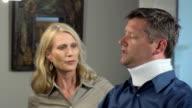 Man Wearing Neck Brace Expresses Discomfort MS video