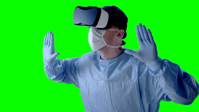 Man wearing virtual reality glasses during medical research. Pushing away imaginary object video
