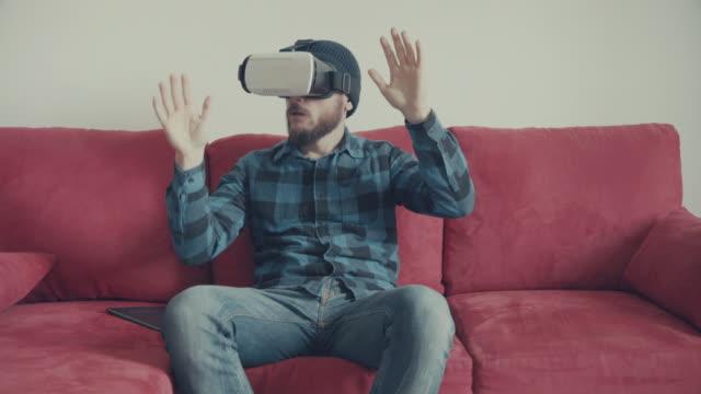 Man wearing virtual reality headset at home video