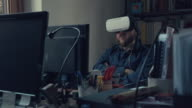 Man wearing virtual reality headset at office video