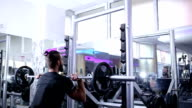Man weightlifting barbells in a gym video