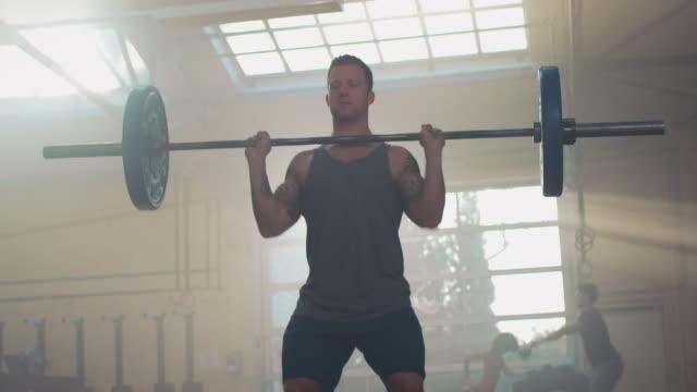 Man weightlifting in gym video
