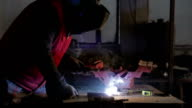 Man welding metal bar video