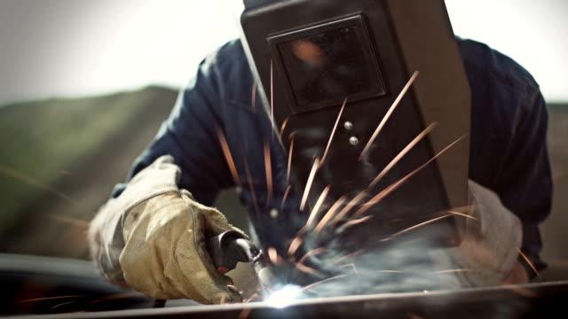 Man welding outside video
