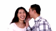 Man whispering joke into girlfriends ear video