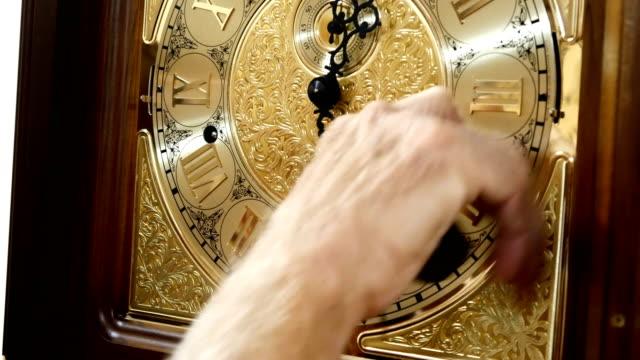 A man winds up a mechanical watch video