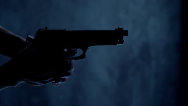 Man with 9 mm handgun takes a shot video