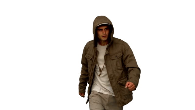 Man with a coat walking toward camera on white screen video