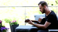 Man with an acoustic guitar video