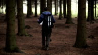 Man with Backpack and map searching directions video