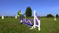 Man with barrier near hurdle video